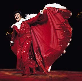 Liberace red cape