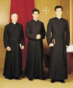 Catholic priests wearing cassocks.