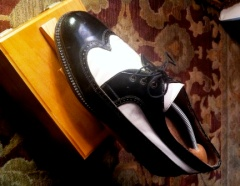 Two-tone leather spectator / correspondents shoes.